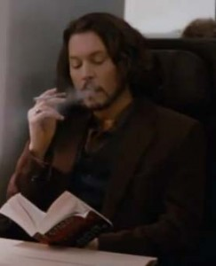 Picture of Depp taking a drag on an electronic cigarette