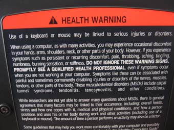 Warning label on back of ergonomic KB.